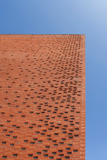 Stock Photo: 1801-71115 Hanson Hq  Tp Bennett  Stewartby  Bedfordshire  Uk  2009. Close Up Shot Showing The Naturally Ventilated Red Brick Work Against The Clear Blue Sky