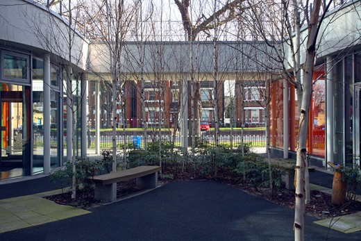 Stock Photo: 1801-71346 Kaleidoscope Children'S Centre  Van Heyningen And Haward Architects. C-Shaped Plan Hugs Central Garden Space.