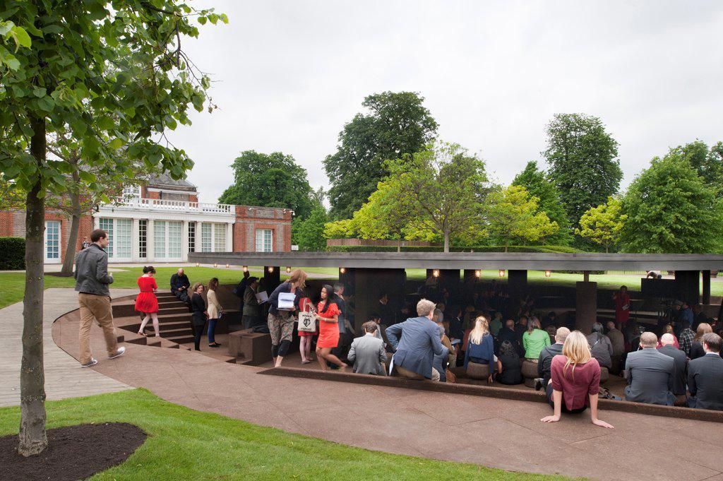 Stock Photo: 1801-72050 Serpentine Pavilion 2012, London, United Kingdom. Architect Herzog & De Meuron and Ai Weiwei, 2012. Crowds gather to listen to Herzog & De Meuron talk about the project.
