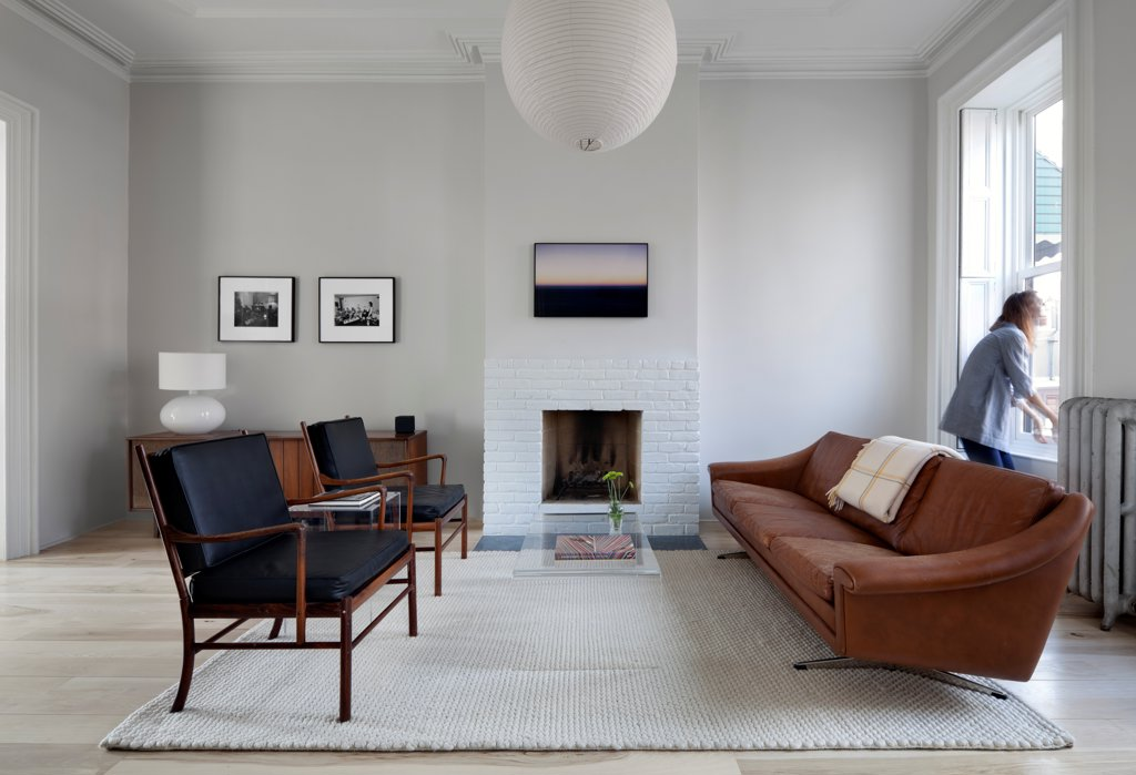 Stock Photo: 1801-72120 Park Slope, Brooklyn Residence, Brooklyn, United States. Architect Davies Tang & Toews , 2012. Vintage modern furniture, fireplace, Isamu Noguchi Akari fixture ceiling light.