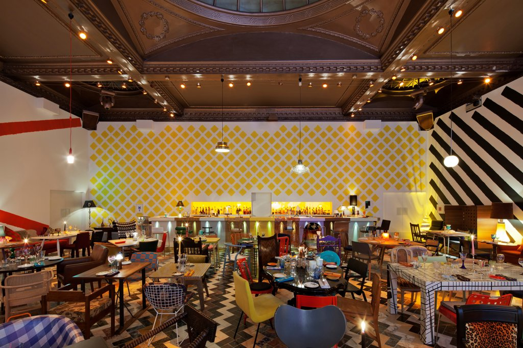 Sketch, London, United Kingdom. Architect Martin Creed, 2012. Colourful restaurant designed by artist Martin Creed. An eclectic mix of mis-matched chairs, tables, glassware, crockery and cutlery. : Stock Photo