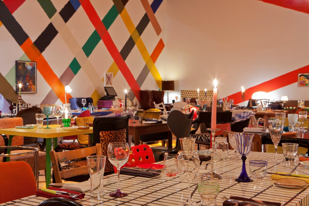 Stock Photo: 1801-72409 Sketch, London, United Kingdom. Architect Martin Creed, 2012. Colourful restaurant designed by artist Martin Creed. An eclectic mix of mis-matched chairs, tables, glassware, crockery and cutlery.