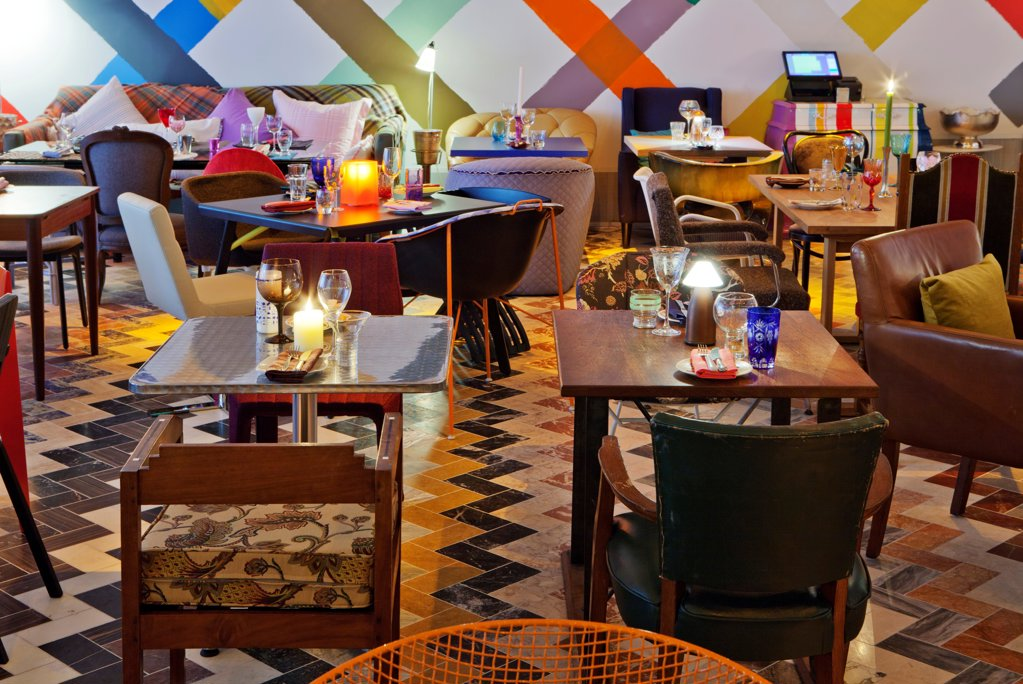 Stock Photo: 1801-72418 Sketch, London, United Kingdom. Architect Martin Creed, 2012. Colourful restaurant designed by artist Martin Creed. An eclectic mix of mis-matched chairs, tables, glassware, crockery and cutlery.