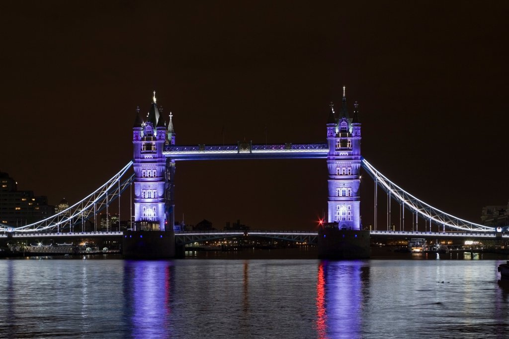 Stock Photo: 1801-72833 Tower Bridge Re-lighting, London, United Kingdom. Architect Horace Jones, 2012. View of Tower Bridge capturing new lighting system from HMS Belfast. Silver Lighting.