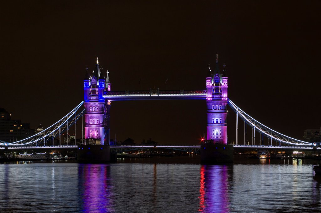Stock Photo: 1801-72837 Tower Bridge Re-lighting, London, United Kingdom. Architect Horace Jones, 2012. View of Tower Bridge capturing new lighting system from HMS Belfast. Purple Lighting.