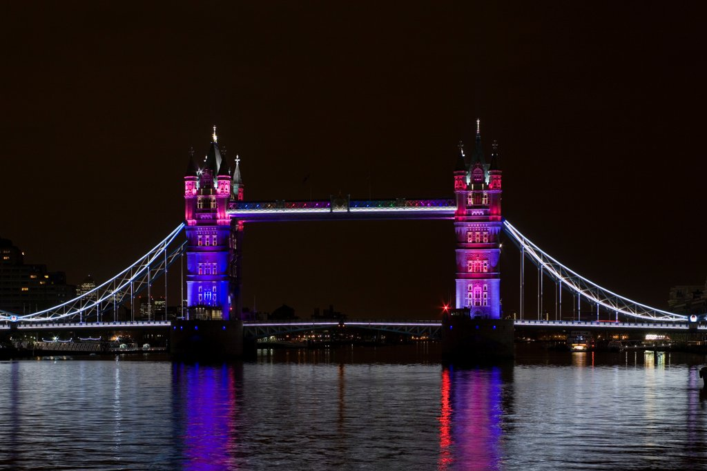 Stock Photo: 1801-72838 Tower Bridge Re-lighting, London, United Kingdom. Architect Horace Jones, 2012. View of Tower Bridge capturing new lighting system from HMS Belfast. Purple Lighting.