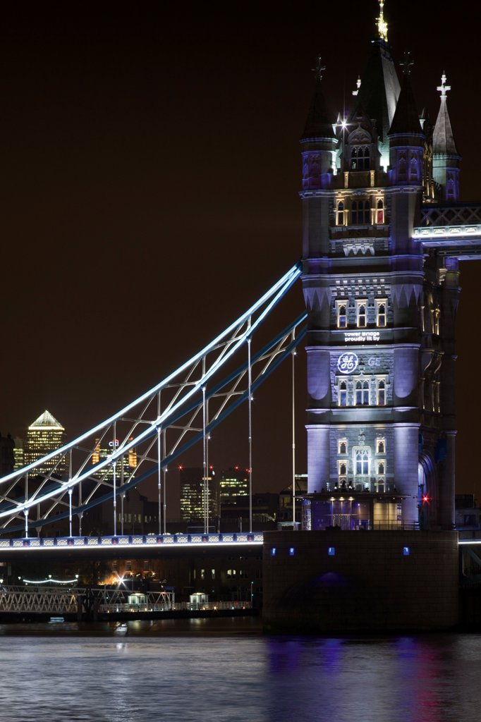 Stock Photo: 1801-72840 Tower Bridge Re-lighting, London, United Kingdom. Architect Horace Jones, 2012. Detail View of Tower Bridge capturing new lighting system from HMS Belfast.
