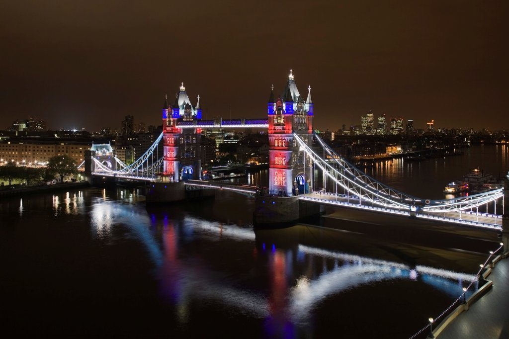 Tower Bridge Re-lighting, London, United Kingdom. Architect Horace Jones, 2012. View of Tower Bridge capturing new lighting system from GLA Building. Red, White & Blue lighting. : Stock Photo