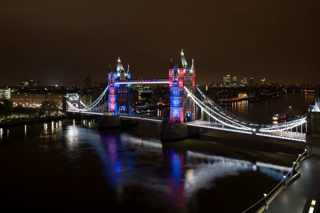 Stock Photo: 1801-72843 Tower Bridge Re-lighting, London, United Kingdom. Architect Horace Jones, 2012. View of Tower Bridge capturing new lighting system from GLA Building. Red, White & Blue lighting.
