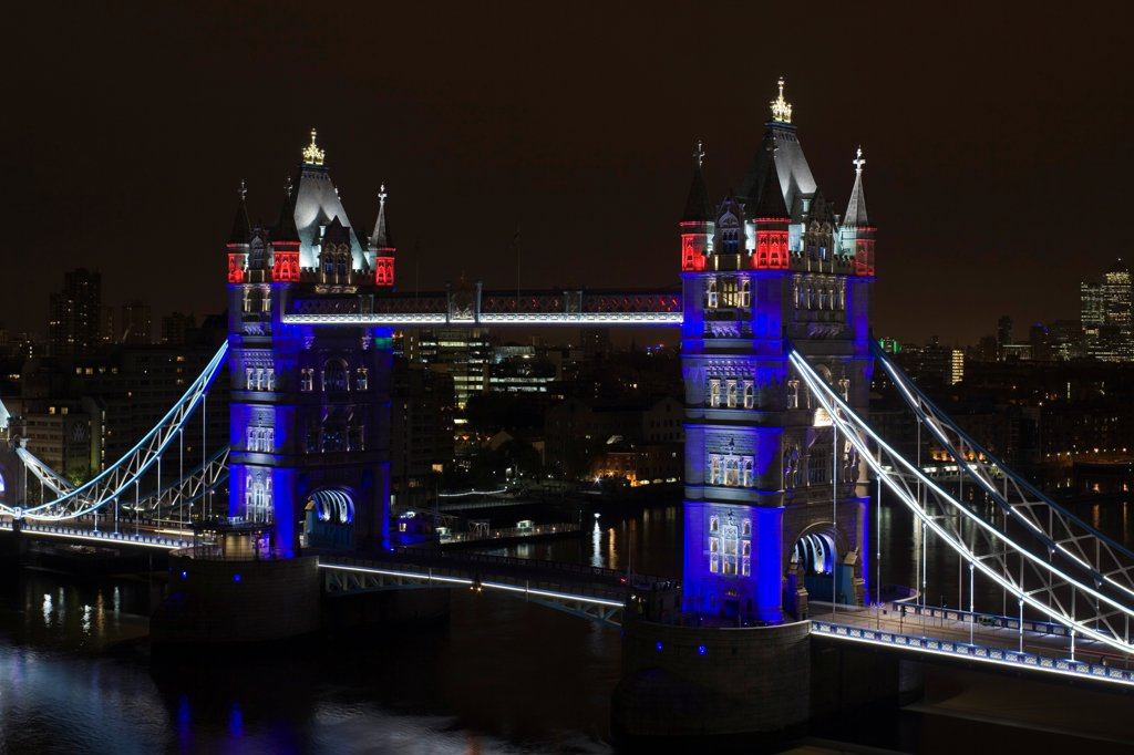 Tower Bridge Re-lighting, London, United Kingdom. Architect Horace Jones, 2012. Detail View of Tower Bridge capturing new lighting system from GLA Building. Red, White & Blue lighting. : Stock Photo