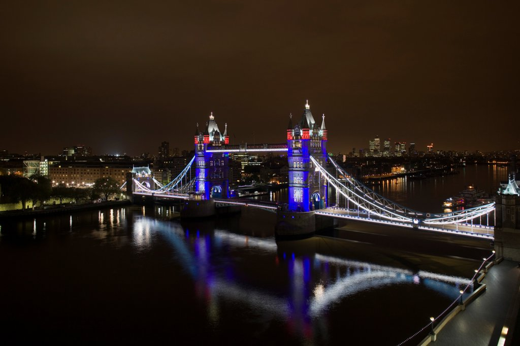Stock Photo: 1801-72847 Tower Bridge Re-lighting, London, United Kingdom. Architect Horace Jones, 2012. View of Tower Bridge capturing new lighting system from GLA Building. Red, White & Blue lighting.