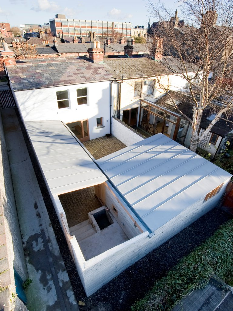 Stock Photo: 1801-73057 Laneway Wall Garden House, Portobello, Ireland. Architect Donaghy + Dimond, 2011. View of extension from above showing courtyards and roofing.