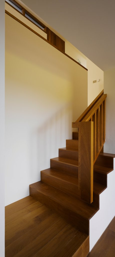Gray House, Howth, Ireland. Architect O'Donnell & Tuomey, 2008. View of stairs showing timber flooring. : Stock Photo