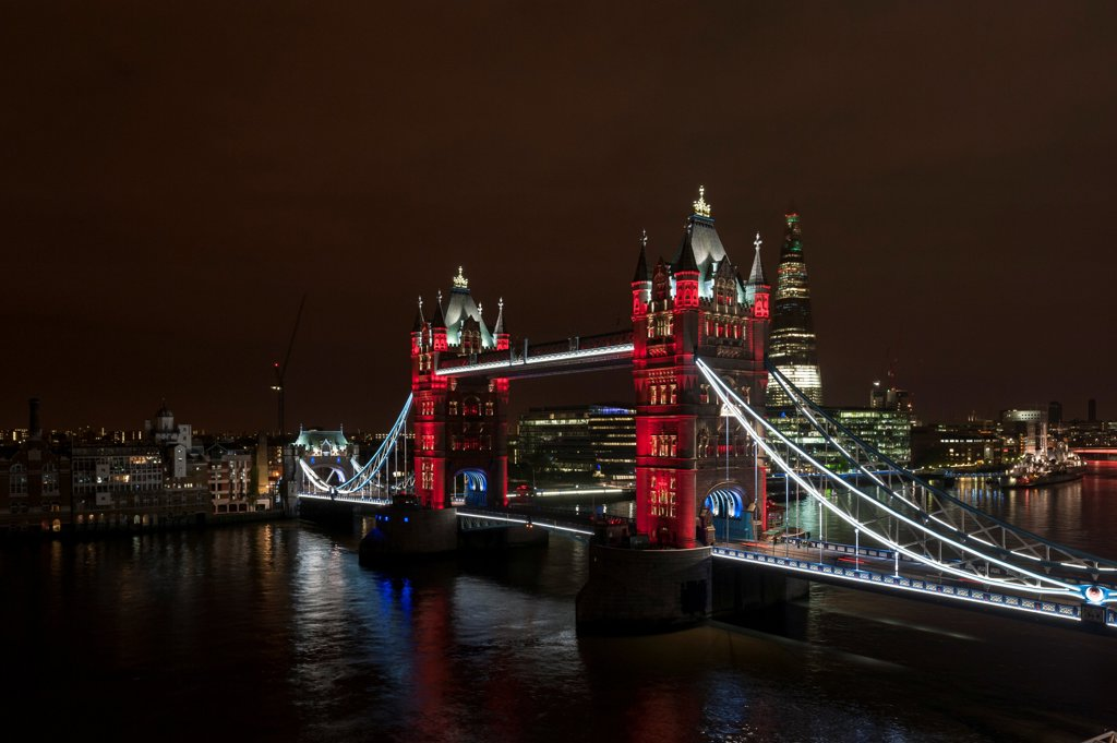 Tower Bridge Re-Lighting, Bridge, Europe, United Kingdom,2012, Horace Jones. View from the Guoman Hotel with red LED setting. : Stock Photo