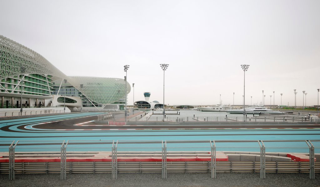 Yas Hotel, Hotel, Asia, United Arab Emirates,2010, Asymptote, Hani Rashid, Lise Anne Couture. General view with light blue race track. : Stock Photo