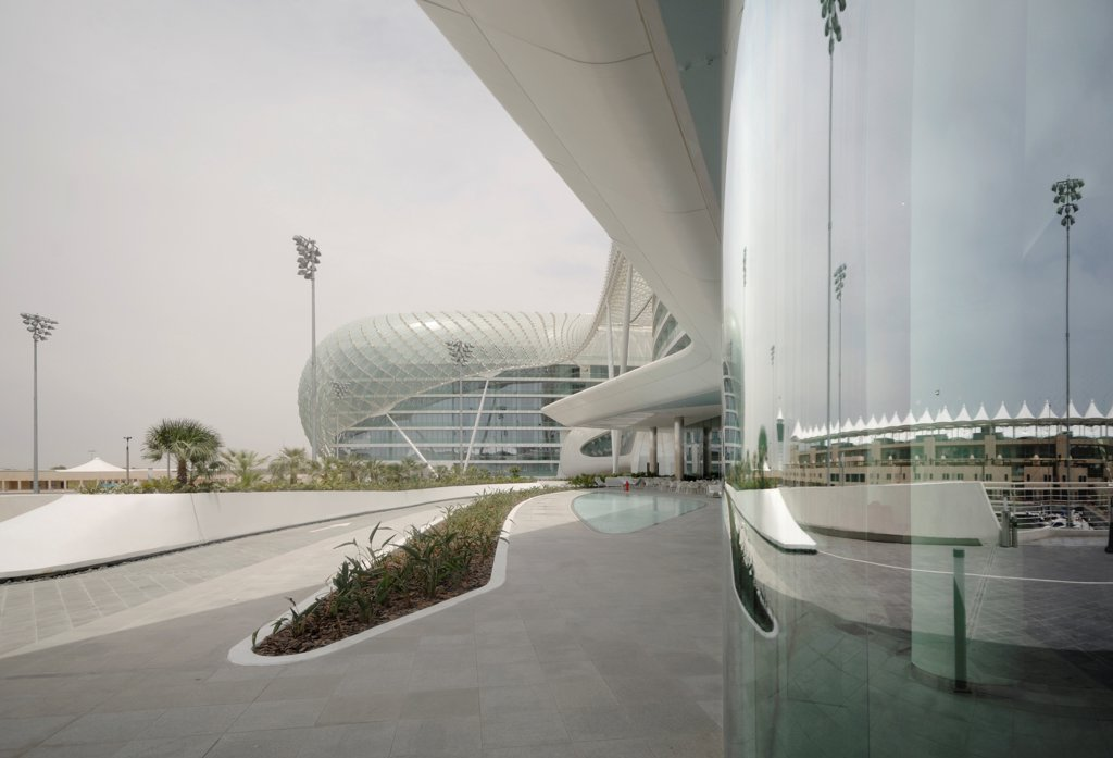 Stock Photo: 1801-73662 Yas Hotel, Hotel, Asia, United Arab Emirates,2010, Asymptote, Hani Rashid, Lise Anne Couture. View of outside driveway and reflections in glass facade.