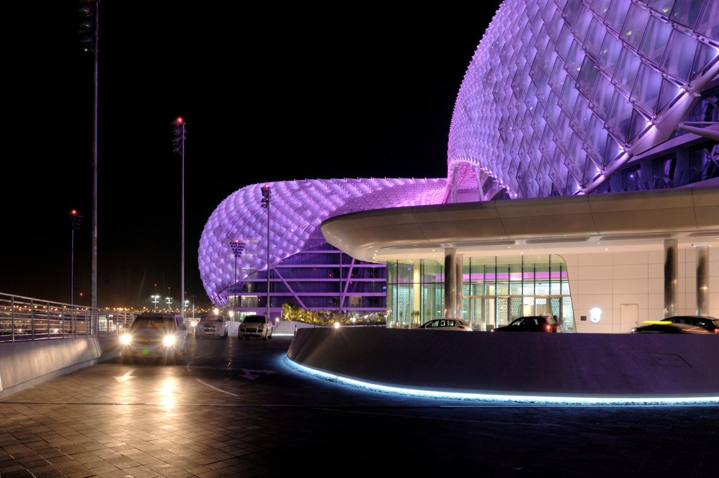 The Yas Hotel, Asymptote, Hani Rashid and Lise Anne Couture, Abu Dhabi, United Arab Emirates 2010 outside view by night, approaching the hotel : Stock Photo