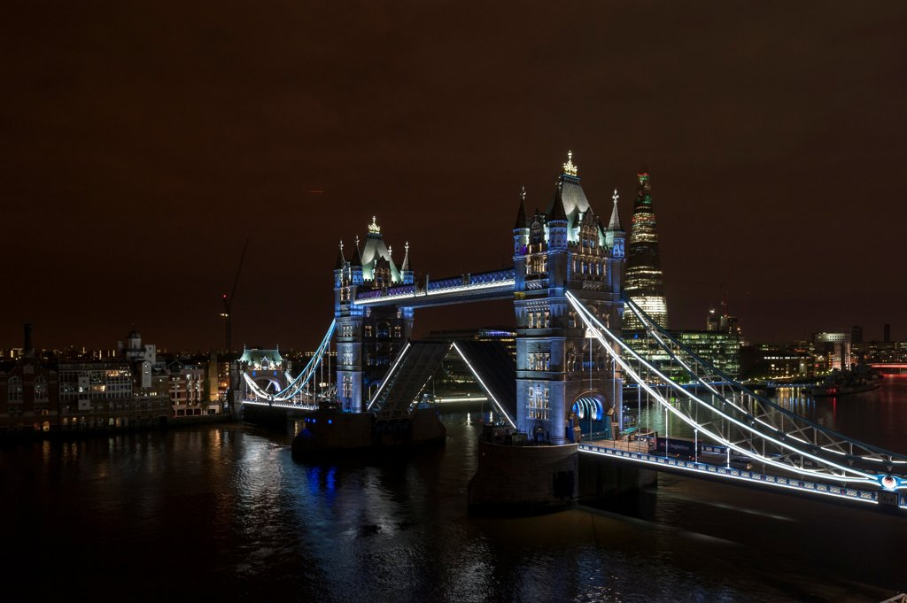 Stock Photo: 1801-73966 Tower Bridge Re-Lighting, London, United Kingdom. Architect: Horace Jones, 2012. View from the Guoman Hotel with bridge in open position.