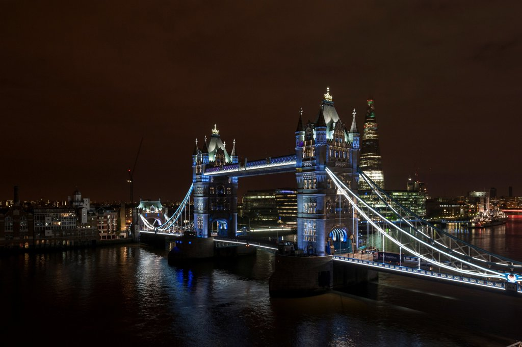 Tower Bridge Re-Lighting, London, United Kingdom. Architect: Horace Jones, 2012. View from the Guoman Hotel with bridge in closed position. : Stock Photo