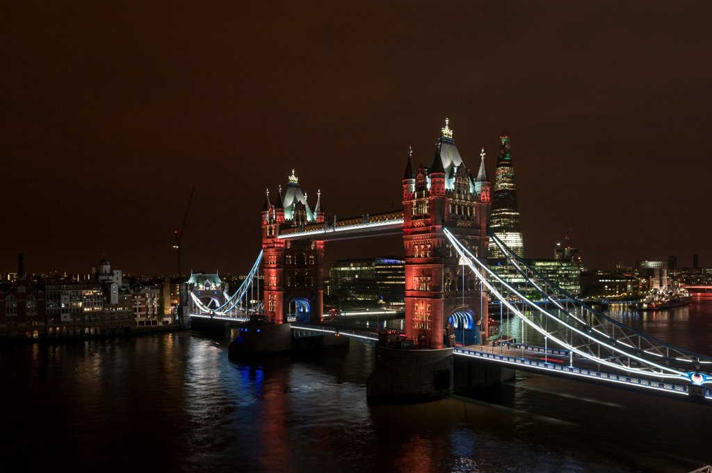 Tower Bridge Re-Lighting, London, United Kingdom. Architect: Horace Jones, 2012. View from the Guoman Hotel with pink LED setting. : Stock Photo