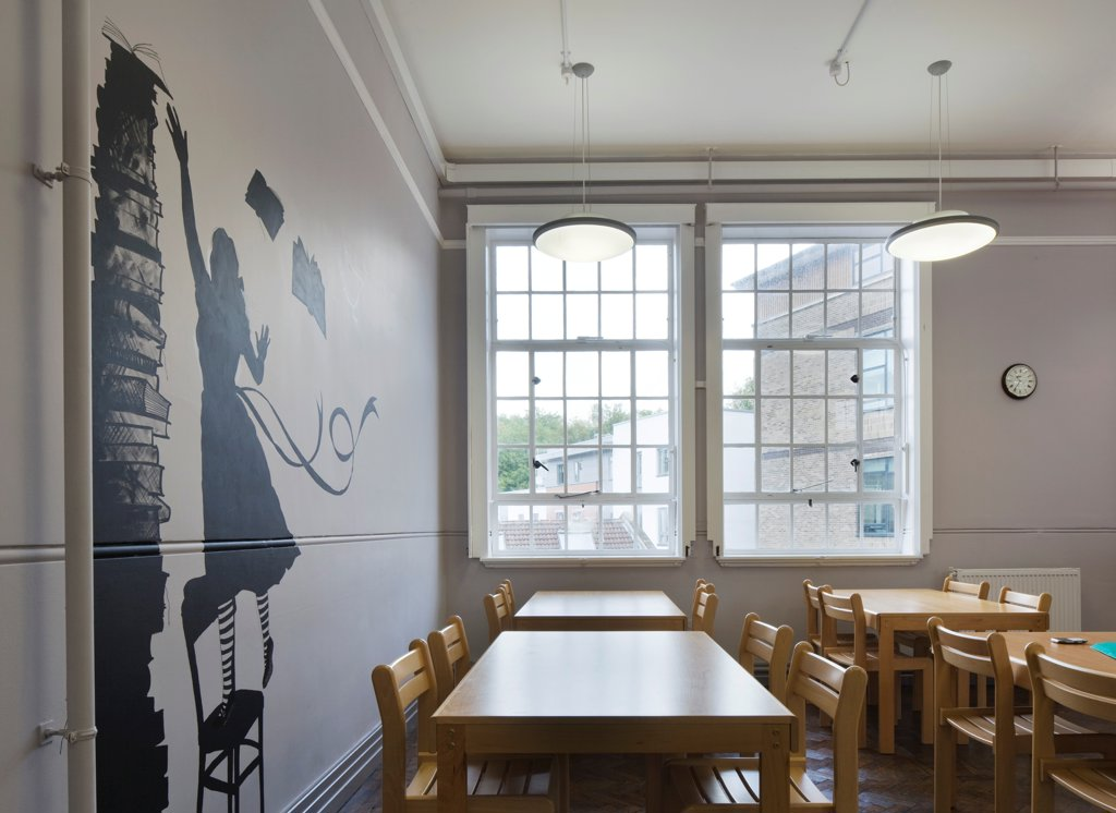 Stock Photo: 1801-73998 Colston's Girls' School, Bristol, United Kingdom. Architect: Walters and Cohen Ltd, 2011. Library interior with view through to neighbouring facades.