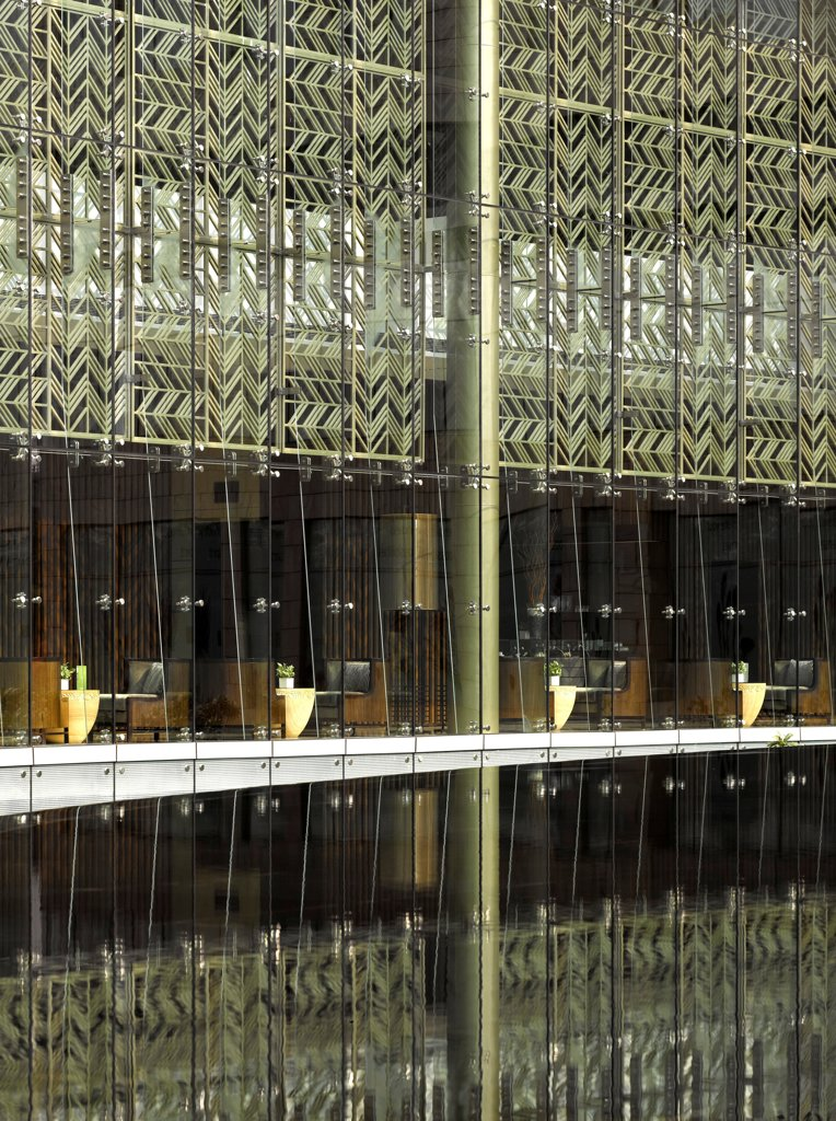 The Westin Hotel, Gurgaon, India. Architect: Studio U+A, 2010. Detail of glazing and reflection in water. : Stock Photo