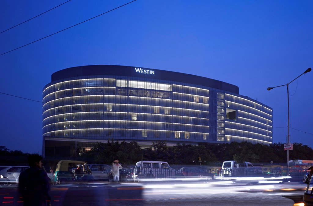 The Westin Hotel, Gurgaon, India. Architect: Studio U+A, 2010. Overall shot at twilight. : Stock Photo