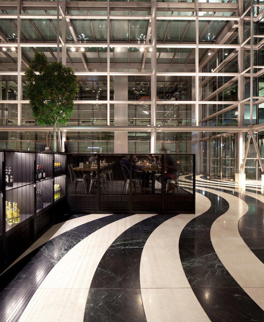 Obika Canary Wharf, London, United Kingdom. Architect: Labics, 2012. View showing wavy black and white stripped flooring. : Stock Photo
