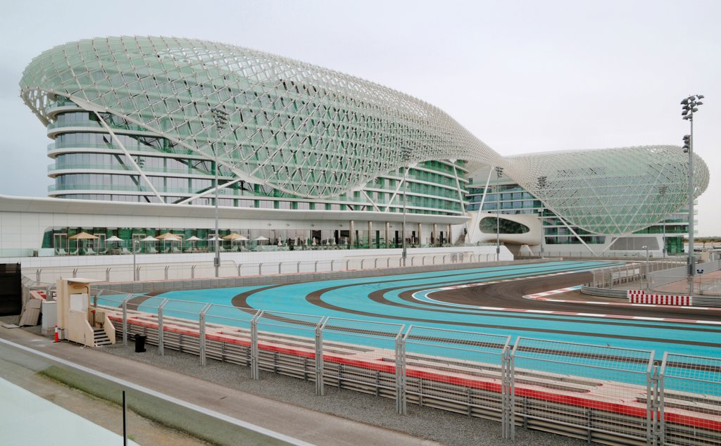 Stock Photo: 1801-74358 Yas Hotel, Abu Dhabi, United Arab Emirates. Architect: Asymptote, Hani Rashid, Lise Anne Couture, 2010. General view with race track.