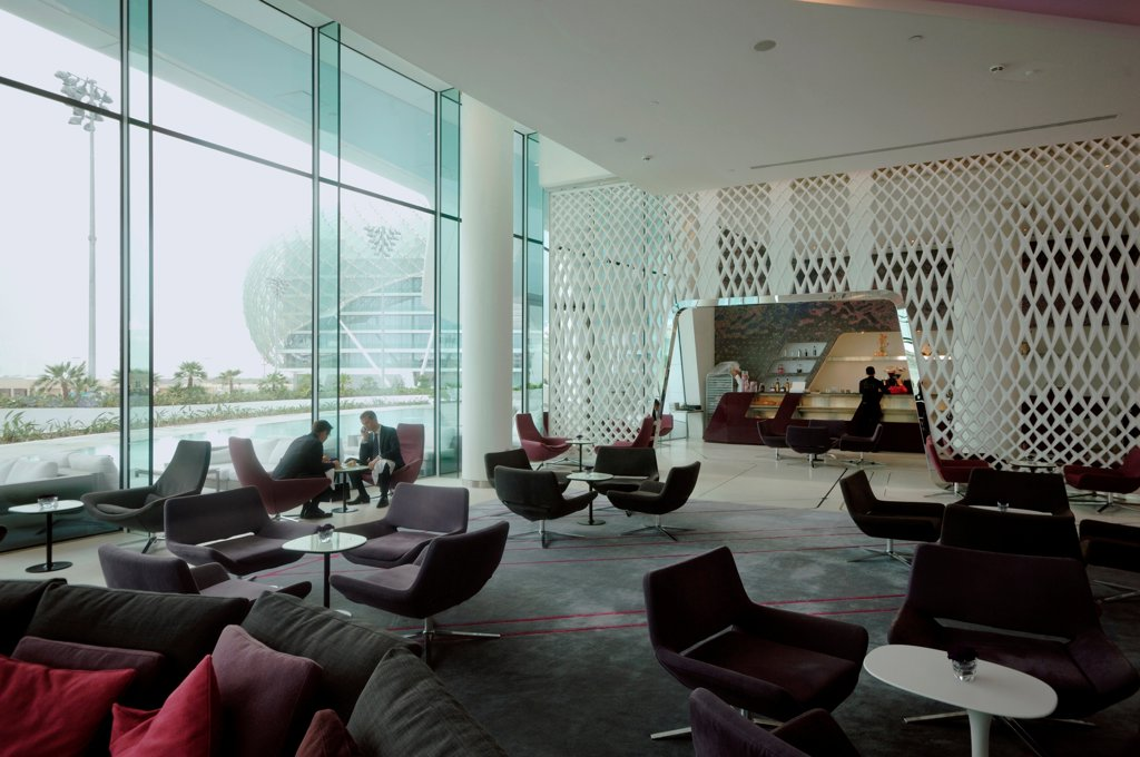 Yas Hotel, Abu Dhabi, United Arab Emirates. Architect: Asymptote, Hani Rashid, Lise Anne Couture, 2010. Lobby with lounge bar. : Stock Photo