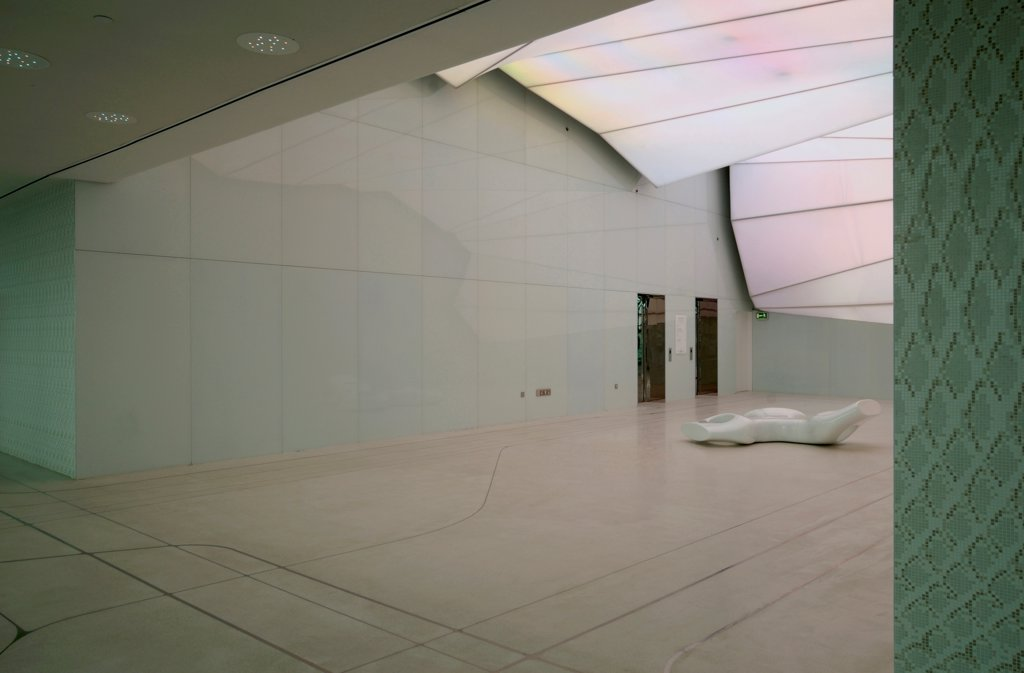 Stock Photo: 1801-74377 Yas Hotel, Abu Dhabi, United Arab Emirates. Architect: Asymptote, Hani Rashid, Lise Anne Couture, 2010. Interior of lobby with Asymptote sculpture, luminous ceiling.