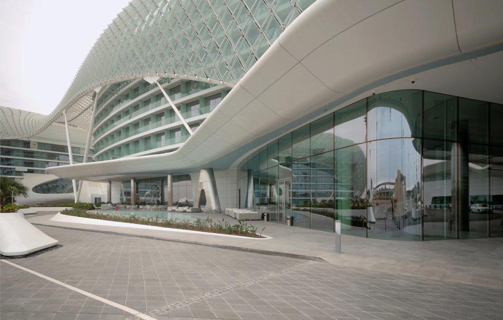 Stock Photo: 1801-74381 Yas Hotel, Abu Dhabi, United Arab Emirates. Architect: Asymptote, Hani Rashid, Lise Anne Couture, 2010. Entrance view.