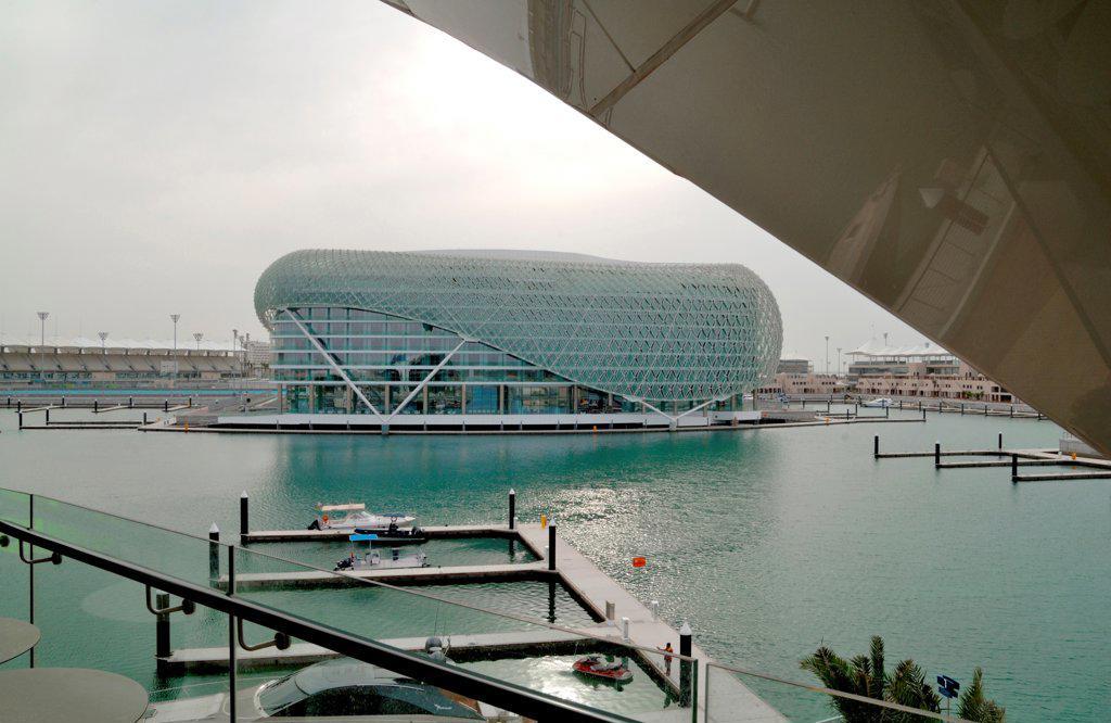 Yas Hotel, Abu Dhabi, United Arab Emirates. Architect: Asymptote, Hani Rashid, Lise Anne Couture, 2010. View from marina. : Stock Photo