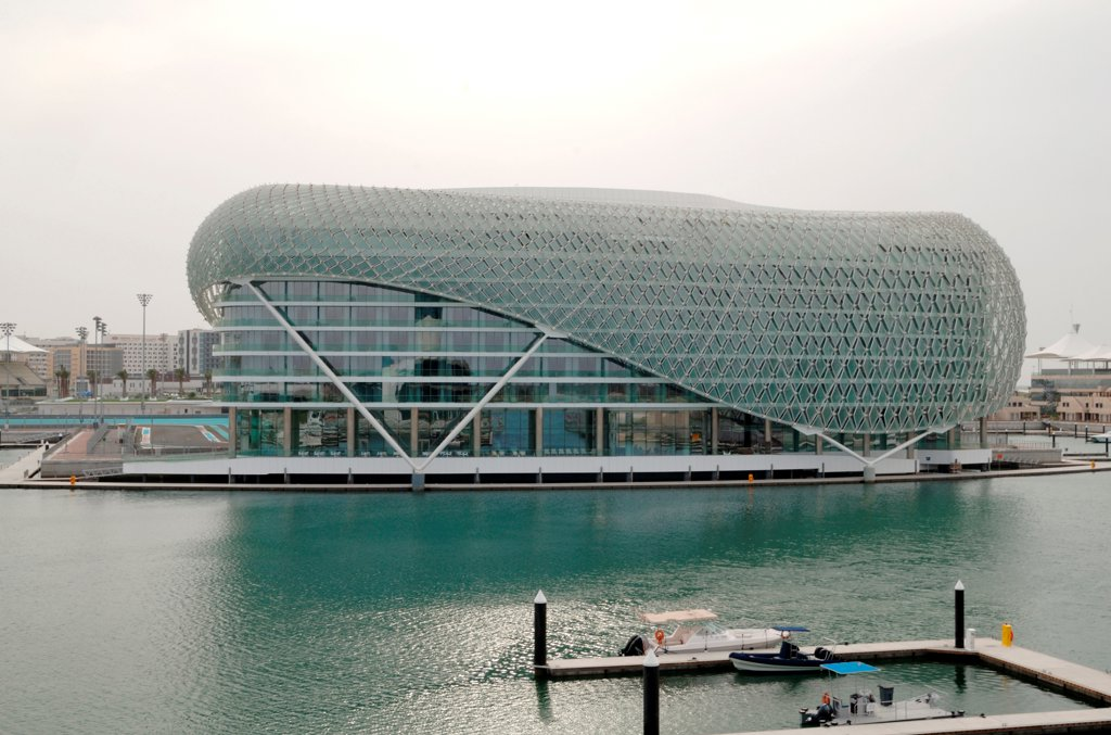 Stock Photo: 1801-74386 Yas Hotel, Abu Dhabi, United Arab Emirates. Architect: Asymptote, Hani Rashid, Lise Anne Couture, 2010. View from marina.