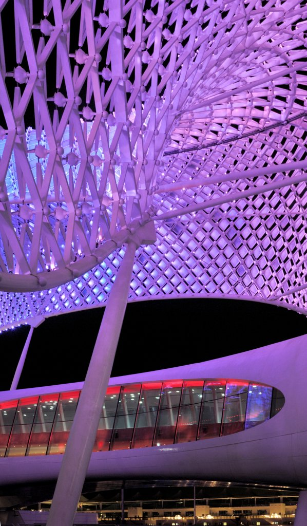Stock Photo: 1801-74399 Yas Hotel, Abu Dhabi, United Arab Emirates. Architect: Asymptote, Hani Rashid, Lise Anne Couture, 2010. Detail of purple LED skin.