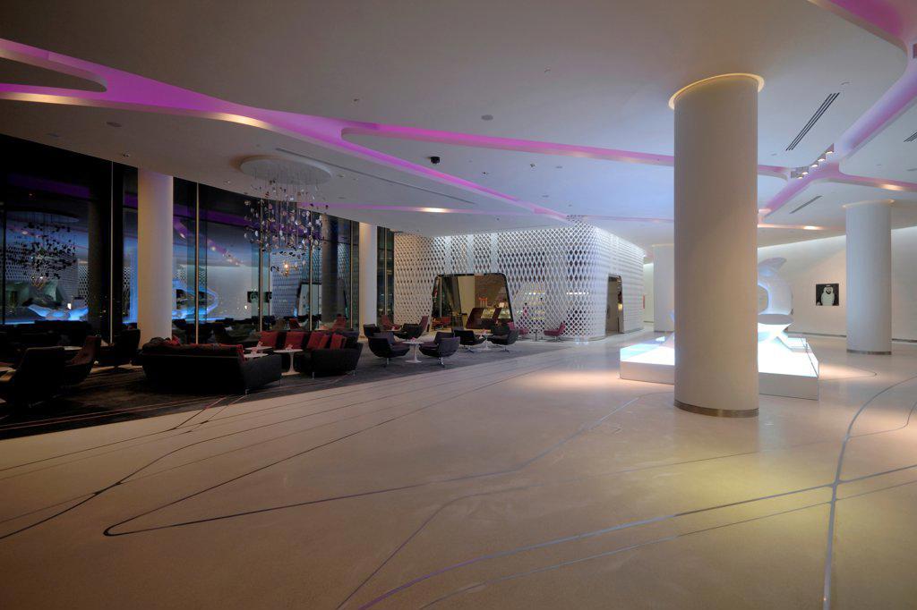 Yas Hotel, Abu Dhabi, United Arab Emirates. Architect: Asymptote, Hani Rashid, Lise Anne Couture, 2010. Lobby. : Stock Photo