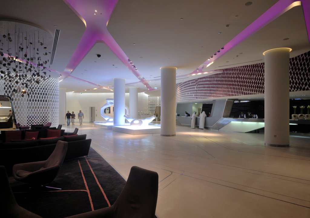 Stock Photo: 1801-74402 Yas Hotel, Abu Dhabi, United Arab Emirates. Architect: Asymptote, Hani Rashid, Lise Anne Couture, 2010. Lobby and lounge.