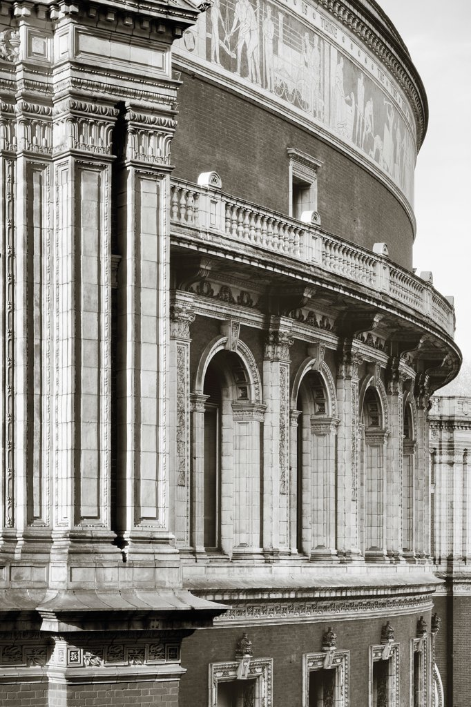 Stock Photo: 1801-74499 Royal Albert Hall, London, United Kingdom. Architect:  Captain Francis Fowke and Major-General Henry Y.D, 1871. Elevated oblique view with column, arches and mosaic frieze.