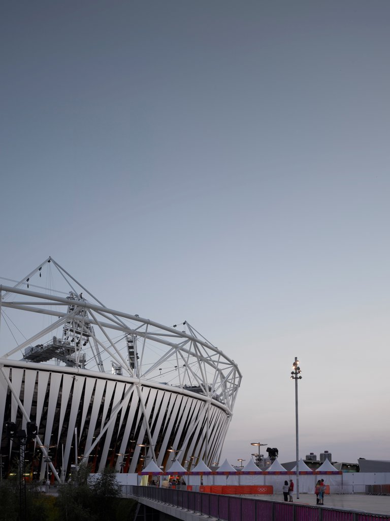 Stock Photo: 1801-74589 Olympic Stadium London 2012, London, United Kingdom. Architect: Populous, 2012. Abstract portrait with evening light.