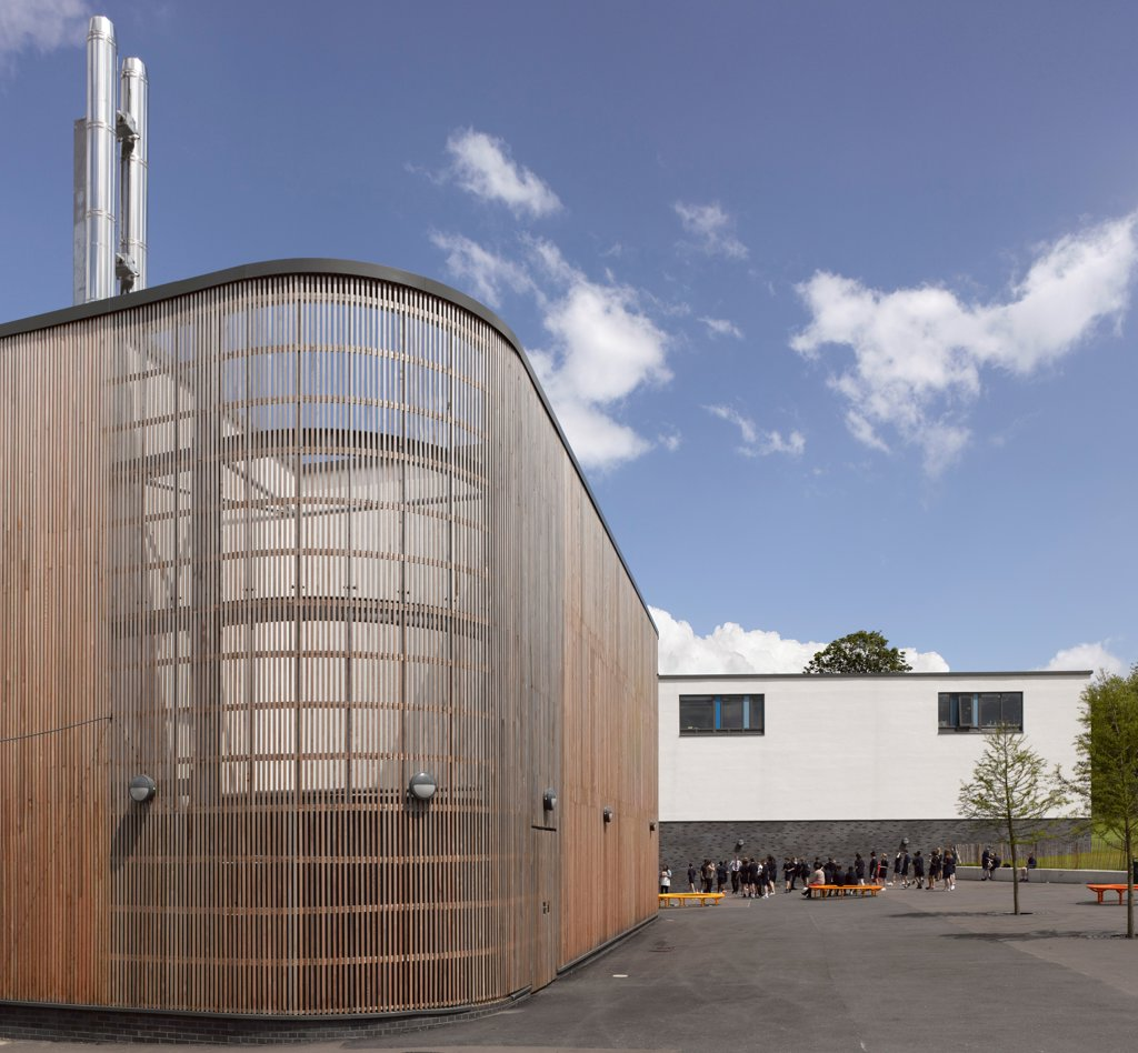 Stanley Park High School, Sutton, United Kingdom. Architect: Haverstock Associates LLP, 2011. View of exterior, timber clad utility plant. : Stock Photo