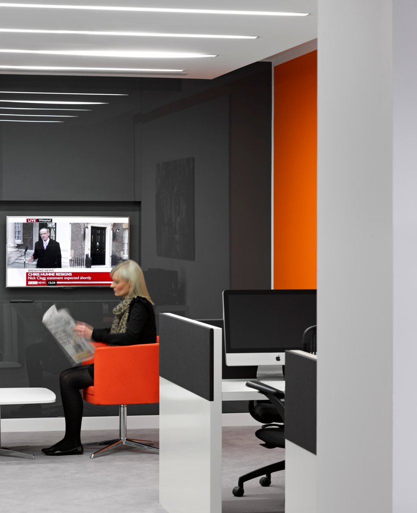ITV Meridian Studio, Southampton, United Kingdom. Architect: Moxon, 2011. Solo figure sitting in reception. : Stock Photo