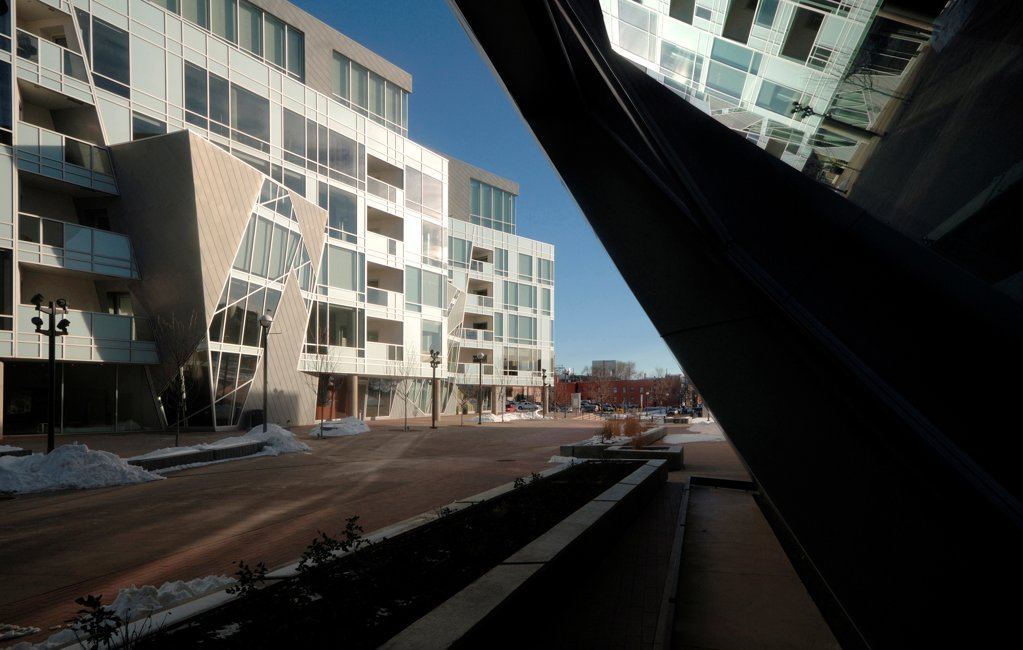 Stock Photo: 1801-75096 Denver Art Museum Residences, Denver, United States. Architect: Daniel Libeskind and Davis Partnership Architects, 2006. Exterior view with reflection in museum window.