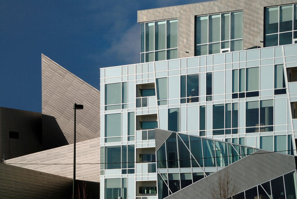 Stock Photo: 1801-75101 Denver Art Museum Residences, Denver, United States. Architect: Daniel Libeskind and Davis Partnership Architects, 2006. Detail of the facade, with museum in the background.