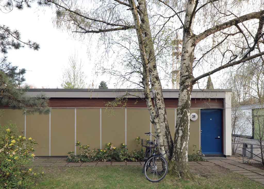 Stock Photo: 1801-75255 Interbau Berlin, Berlin, Germany. Architect: Various Architects, 1957. Arne Jacobsen single story apartment with bicycle in the front garden.