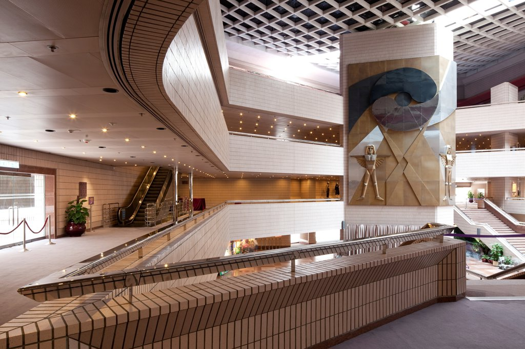 Stock Photo: 1801-75288 Hong Kong Cultural Centre, Kowloon, Hong Kong. Architect: Pau Shiu-hung, 1989. First floor balcony leading to the stairs with bas relief mural on the column.