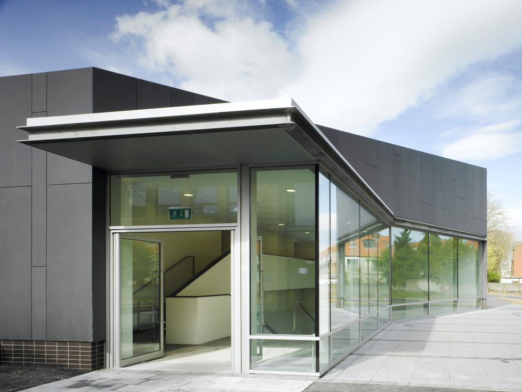 Stock Photo: 1801-75345 Sandford Park School, Ranelagh, Ireland. Architect: DTA Architects, 2007. View of entrance to multipurpose hall showing path to entrance and fibrecement cladding.