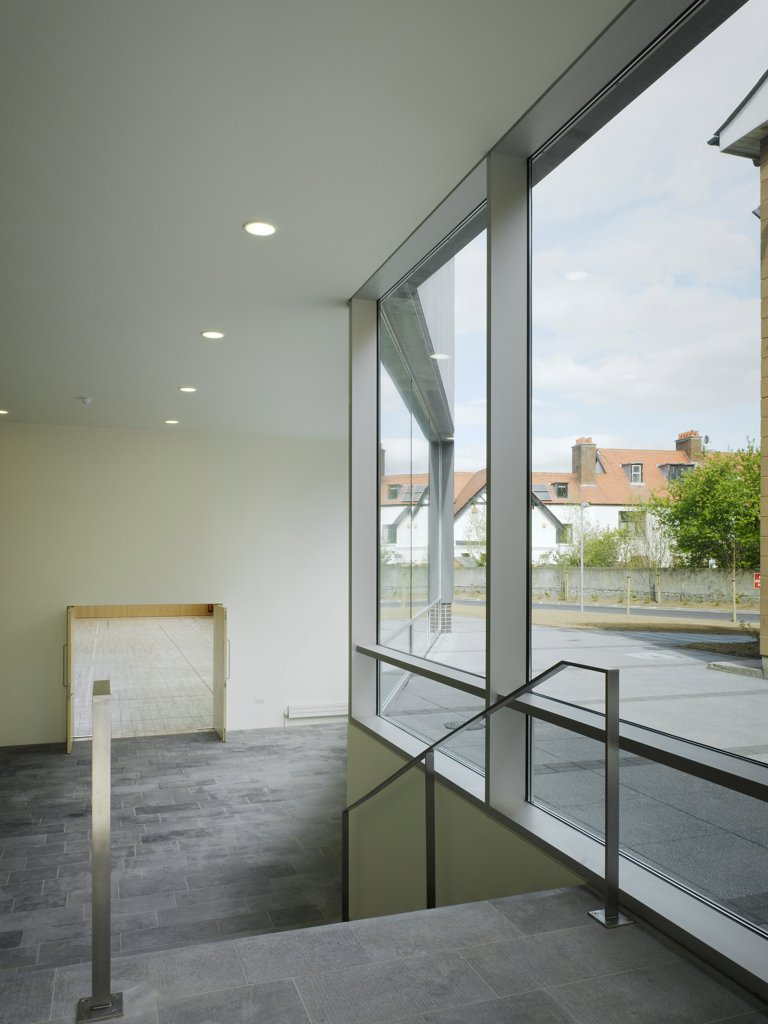 Stock Photo: 1801-75346 Sandford Park School, Ranelagh, Ireland. Architect: DTA Architects, 2007. View from entrance to multipurpose hall showing view to exterior and view to hall.