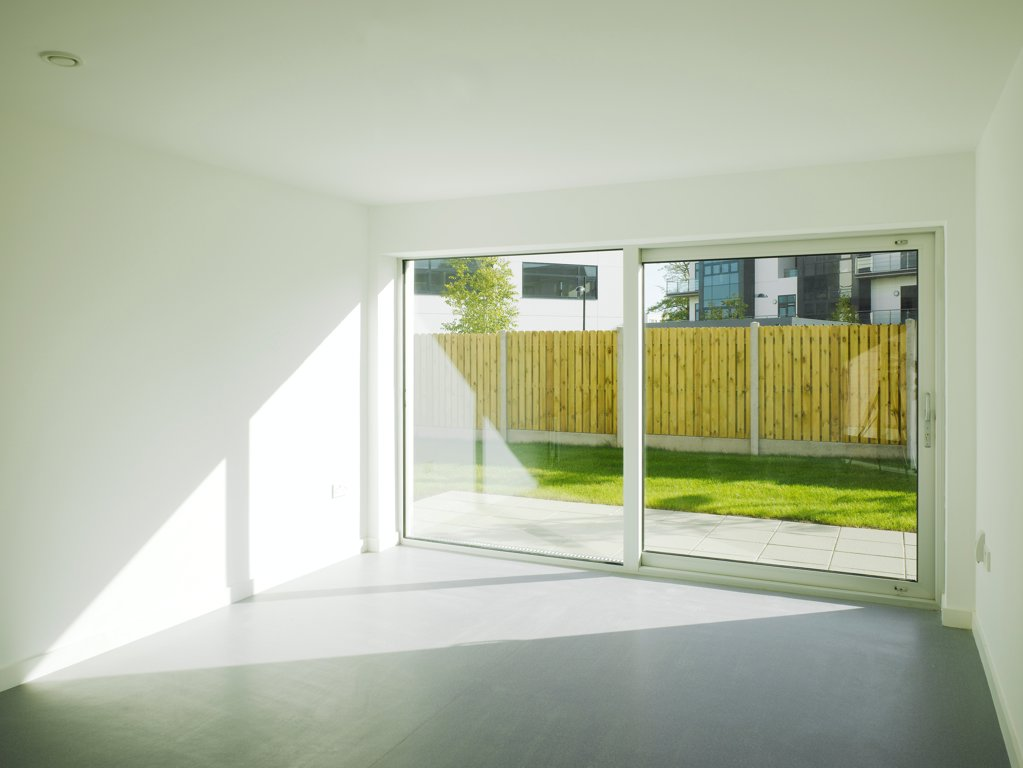 Stock Photo: 1801-75400 Santry Demesne, Fingal, Ireland. Architect: DTA Architects, 2009. View of living space showing view to exterior.