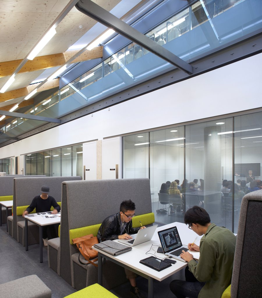 Central Saint Martins, London, United Kingdom. Architect: Stanton Williams, 2011. Students working. : Stock Photo