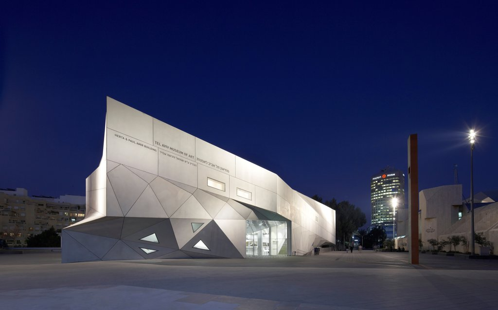 Stock Photo: 1801-76203 Tel Aviv Museum of Art, Tel Aviv, Israel. Architect: Preston Scott Cohen, 2011. Exterior elevation at night.